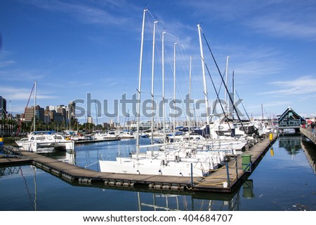 DURBAN, SOUTH AFRICA - APRIL,8, 2016: Many Yachts moored in harbor at Wilsons Wharf against city skyline in Durban South Africa