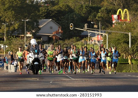 DURBAN, SOUTH AFRICA â?? MAY 31: Group of men run through Hillcrest, Gift Kelehe goes on to win the 2015 Comrades marathon up run for South Africa in Kwa Zulu Natal, South Africa on May 31, 2015.