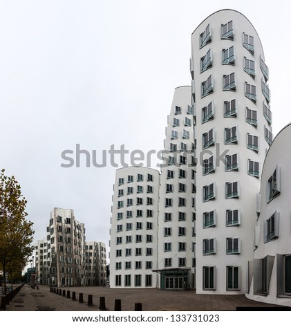 DUSSELDORF, GERMANY - OCTOBER 13: View of the Neuer Zollhof in Media Harbor in Dusseldorf, Germany on October 13, 2012. This building complex was designed by Frank O. Gehry and completed in 1998.