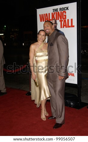 "DWAYNE ""THE ROCK"" JOHNSON & wife DANY GARCIA at the world premiere, in Hollywood, of his new movie Walking Tall. March 29, 2004"