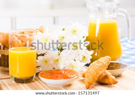early breakfast, juice, croissants and jam, still life