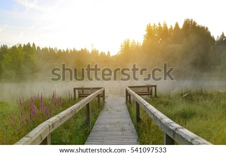 Early morning at wooden pier on lake in Germany