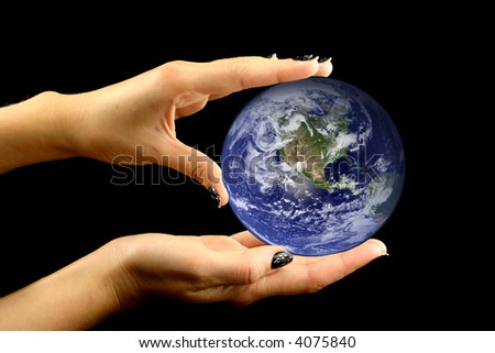 Earth being slightly held in woman's hands on a black background. Image of earth used under Terms and Condintions of Nasa http://visibleearth.nasa.gov