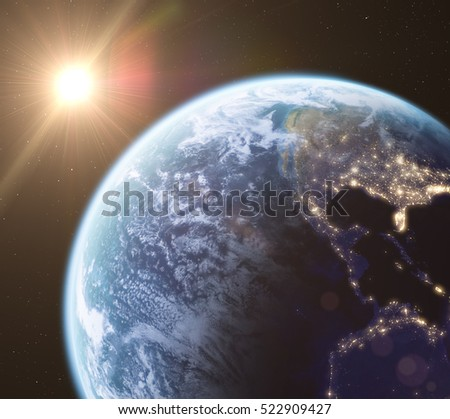Earth in space and rising sun, 3d render. Earth and clouds textures taken from Nasa.gov