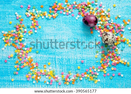 Easter background confectioner's sugar and quail eggs on a wooden table
