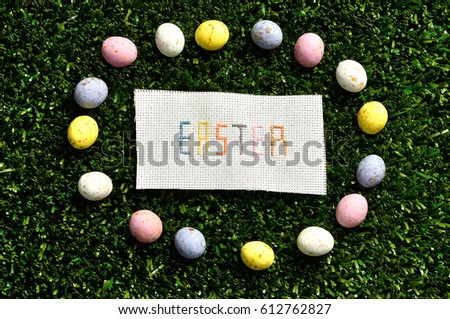 Easter Cross Stitched On Textile Isolated Artificial Grass Displayed With Speckleld Eggs