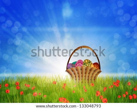 Easter eggs are in basket on a sunny poppy field background.