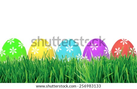 Easter eggs in green grass isolated on white