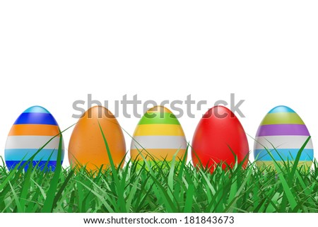 Easter eggs on green grass on a white background