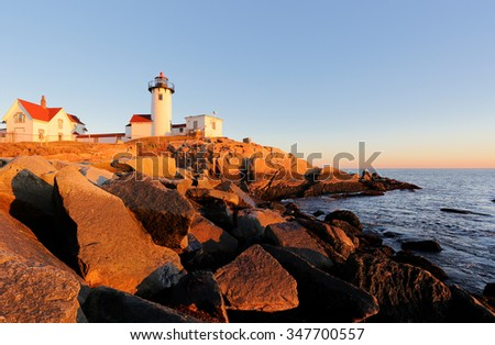 Eastern Point Lighthouse at Gloucester at Sunset, Massachusetts, USA. One of the five iconic lighthouses have been built along the Cape Ann coastline to protect seafarers from rocky shores and shoals.