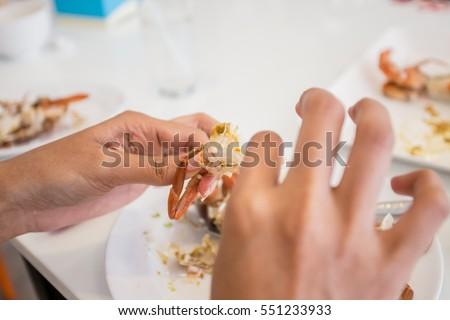 Closeup woman eating restaurant stock photo 576591745 for Food bar hands
