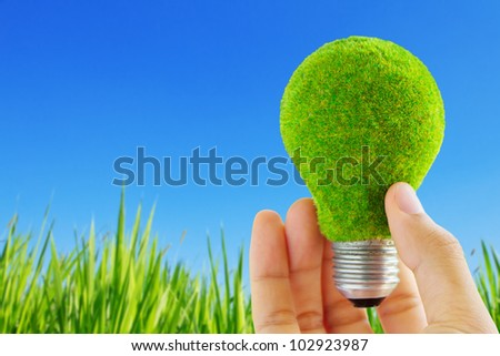 eco light blub in hand, energy concept
