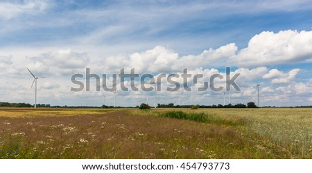 Eco power, wind turbines on the flowering field, Germany