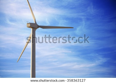 Ecological and renewable energy wind mill against sky with copyspace