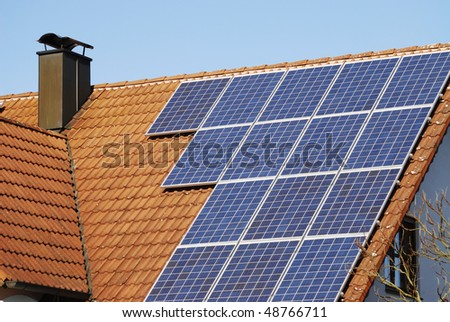 Ecological house roof with solar panels