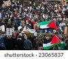 EDINBURGH - JANUARY 10: Anti-Israel protesters listen to speakers in Princes Street Gardens January 10th, 2009 in Edinburgh, Scotland. - stock photo