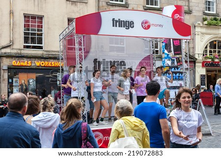 EDINBURGH, SCOTLAND: AUGUST 8, 2014: Artists performing on Fringe festival. Fringe is the very popular and largest arts festival in the world.