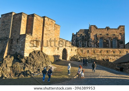 Edinburgh, Scotland - December 23, 2015: Group of tourists visit the medieval castle in Edinburgh, major tourist landmark in  Scotland and the UK