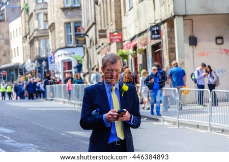 EDINBURGH, SCOTLAND - JULY 2, 2016: Willie Rennie, the leader of the Scottish Liberal Democrat Party and MSP for North East Fife,walking down the Royal Mile after giving a talk at Edinburgh Pride