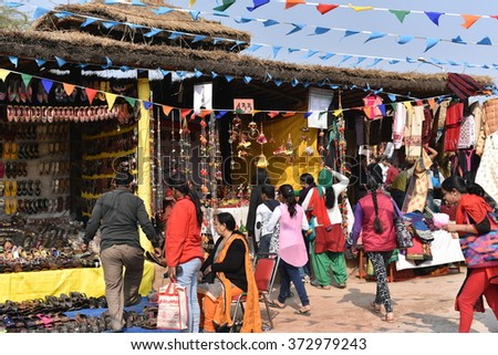 Editorial: Surajkund, Haryana, India:Feb 06th, 2016: People enjoying in 30th International crafts Carnival. The fair focuses on rich showcase of regional and international crafts and traditions