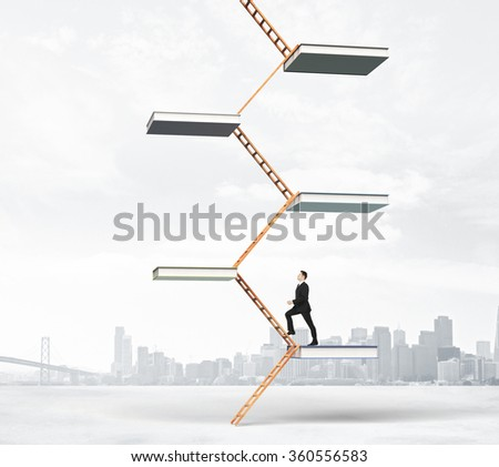 Education ladder concept with  businessman climbs up the stairs of books