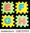 EFGH Alphabet learning blocks isolated Black - stock photo