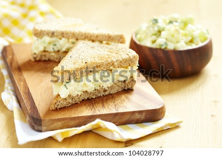 Egg salad sandwich with cucumber, chive and cream cheese