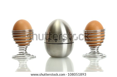 egg timer and egg in metal stand isolated on white