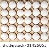eggs in packing on a white background - stock photo