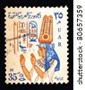 EGYPT - CIRCA 1958: Stamps printed in Egypt showing  hieroglyphic symbol and a depiction of an ancient Egyptian woman with an ornate headgear, circa 1958. - stock photo
