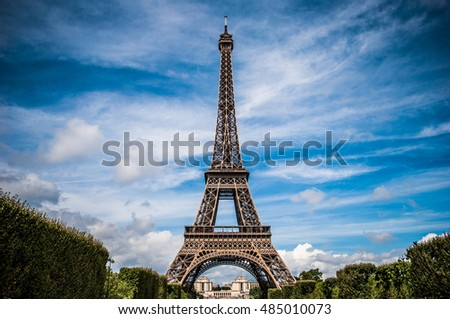 Eiffel Tower Paris with blue sky and clouds.