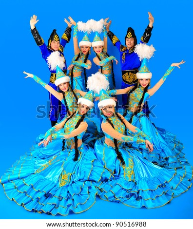 Eight people in the Kazakh national costumes