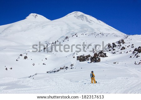 Elbrus - a sleeping volcano and snowboarder