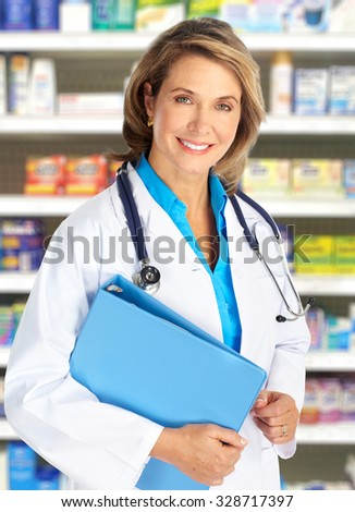 Elderly clinic doctor woman over pharmacy background.