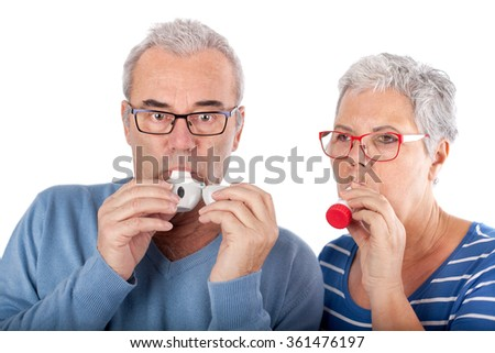 elderly couple with asthma spray breathing