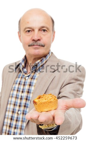 elderly man suggests delicious muffin or cupcake