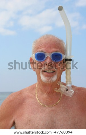 Elderly man with snorkel gear