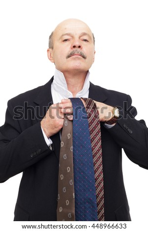 elderly person chooses  tie for business suit