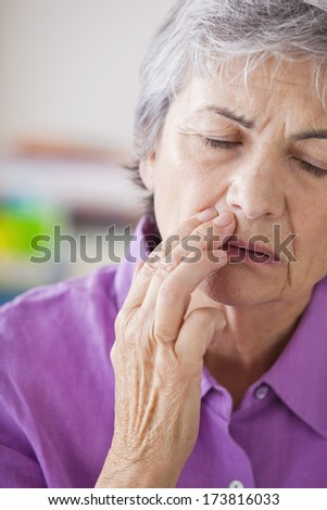 Elderly Person With A Toothache