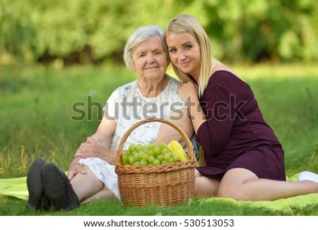 Elderly woman and young woman at the picnic.