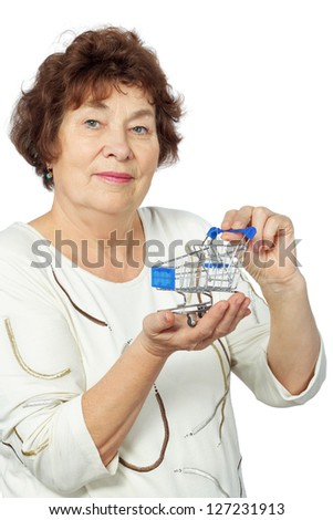 Elderly woman holds toy shopping cart in her hands