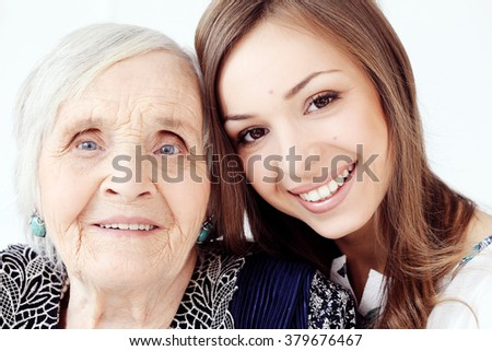Elderly woman with her granddaughter