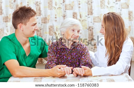 Elderly woman with the two young grandchild