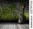 Electric guitar in the empty room concept - stock photo