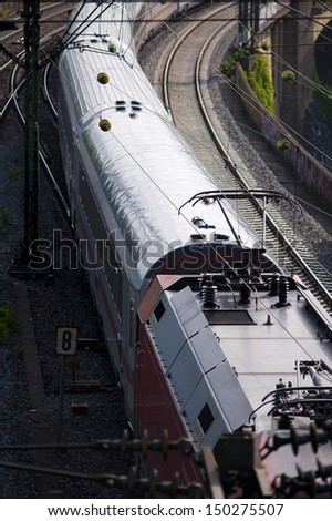 electric locomotive with wagons - shot from the top - from a rail tunnel