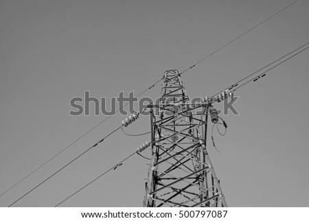 Electric power tower under the blue sky, closeup of photo