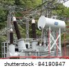 Electric substation attached to a hydroelectric plant with transformers and regulators - stock photo