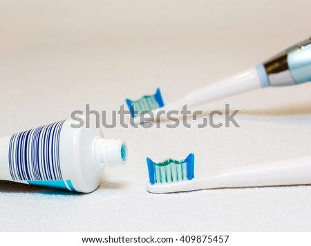 Electric toothbrush on a white background, personal hygiene, the instrument