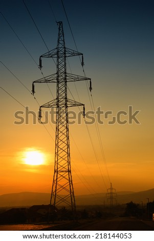 Electric tower at sunset with sun