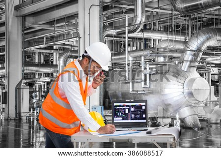 electrical engineer working at control room of a modern thermal power plant - Power Plant Engineer